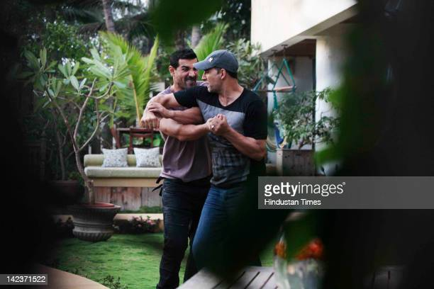 Bollywood Actors Akshay Kumar and John Abraham brawling with each other after the private screening for their upcoming movie Housefull 2 on March 30...