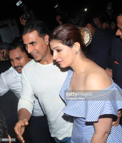Bollywood actors Akshay Kumar with Twinkle Khanna arrive to attend the 45th birthday celebration party of filmmaker Karan Johar at his residence on...