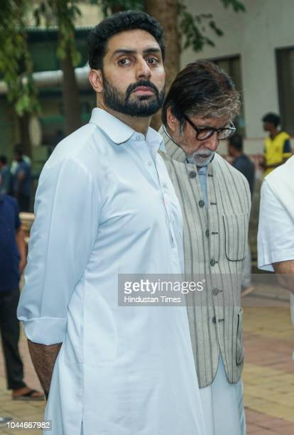 Bollywood actors Amitabh Bachchan and Abhishek Bachchan during Krishna Raj Kapoor's funeral at Chembur on October 1 2018 in Mumbai India