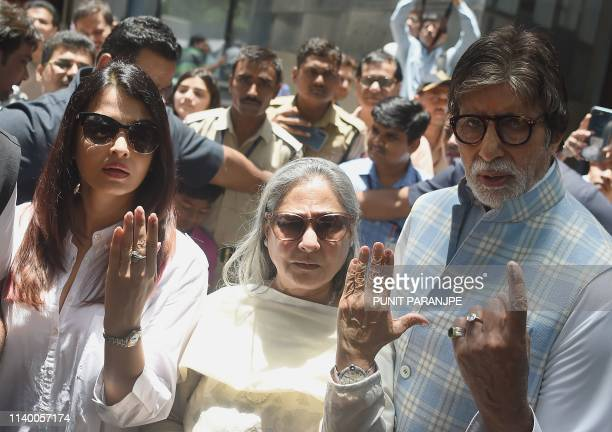 TOPSHOT Bollywood actors Amitabh Bachchan wife Jaya and daughter in law Aishwarya Rai Bachchan pose for a picture after casting their vote at a...