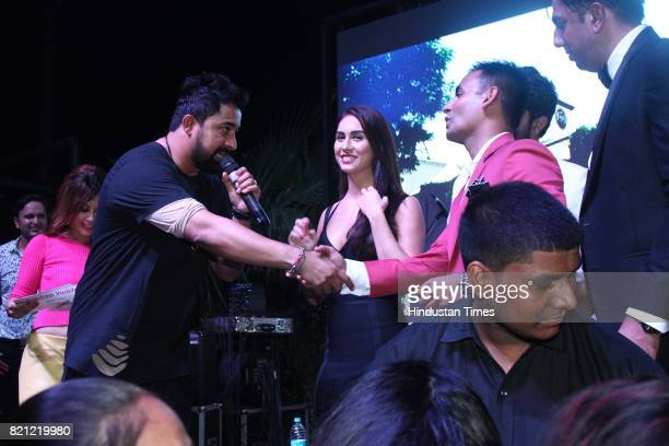 Bollywood actors and anchors Rannvijay Singh and Lauren Gottlieb during the launch of Ministry of Beer on July 14 2017 in Gurgaon India