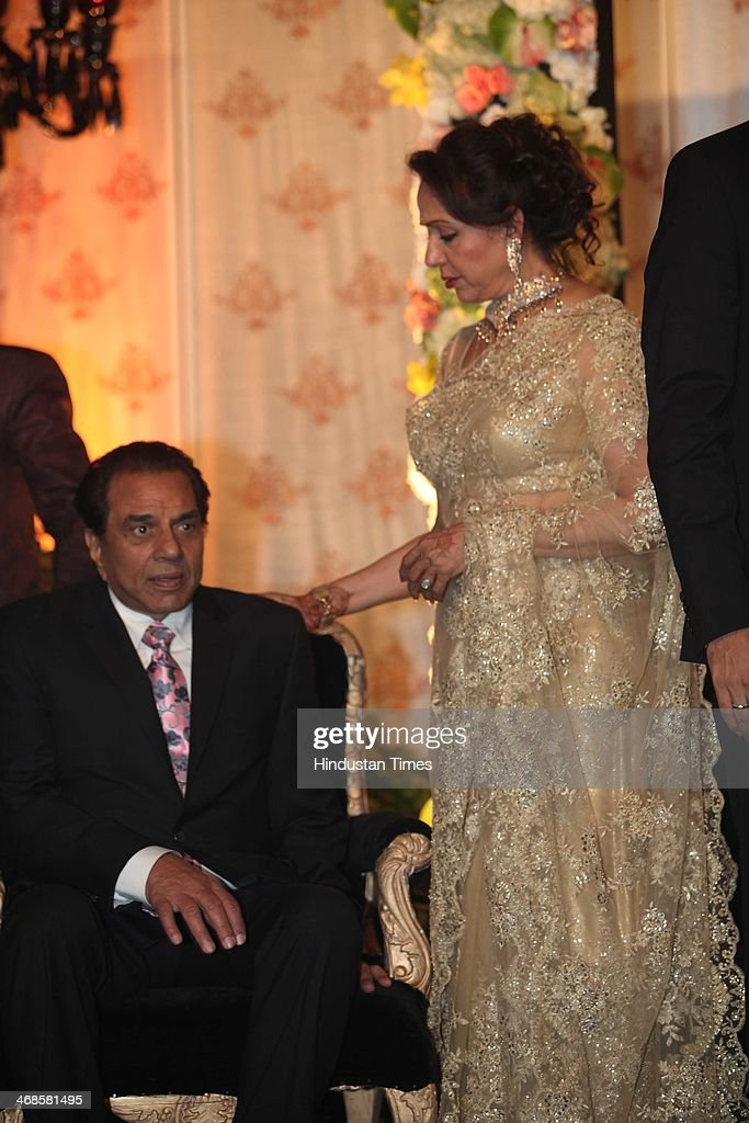 Bollywood actors Dharmendra (L) and Hema Malini (R) during the wedding reception of their daughter Ahana Deol and Vaibhav Vohra on February 5, 2014 in New Delhi, India. Ahana, a budding Odissi dancer, is the daughter of Bollywood stars Dharmendra and Hema Malini while Vaibhav in an Indian businessman. They married on February 2, 2014 in Mumbai.