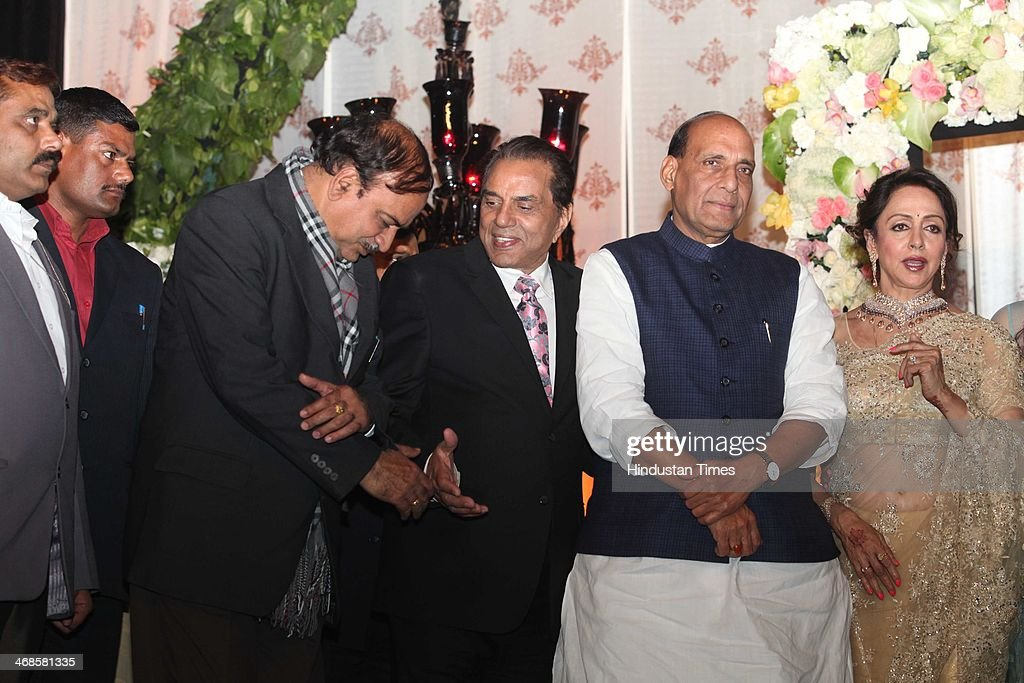 Bollywood actors Dharmendra (C) and Hema Malini (R) with BJP leaders Rajnath Singh (2 R) and Anant Singh (L) during the wedding reception of their daughter Ahana Deol and Vaibhav Vohra on February 5, 2014 in New Delhi, India. Ahana, a budding Odissi dancer, is the daughter of Bollywood stars Dharmendra and Hema Malini while Vaibhav in an Indian businessman. They married on February 2, 2014 in Mumbai.