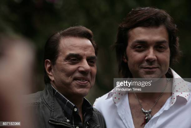 Bollywood actors Dharmendra and his son Bobby Deol celebrate 'Father's Day' during the promotional conference of 'Apne' in Mumbai on Sunday