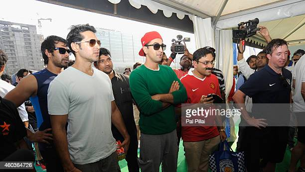 Bollywood actors Dino Morea Ranbir Kapoor and Robbie Fowler Liverpool Legend at the Everton tent during the Barclays Premier League 'Live' event on...