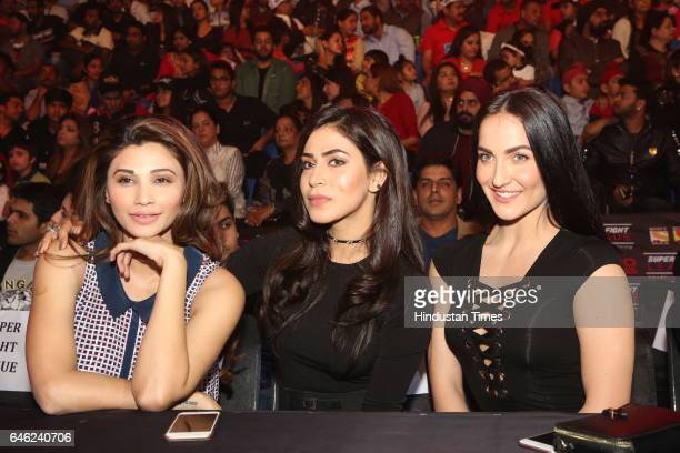 Bollywood actors Elli Avram and Daisy Shah during the Super Fight League at Siri Fort Sports Complex on February 25 2017 in New Delhi India