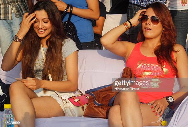 Bollywood actors Gauhar Khan Udita Goswami attend the Marathon Noida 10k from Ramleela Ground, Noida Stadium at Sector 21A on July 8, 2012 in Noida,...