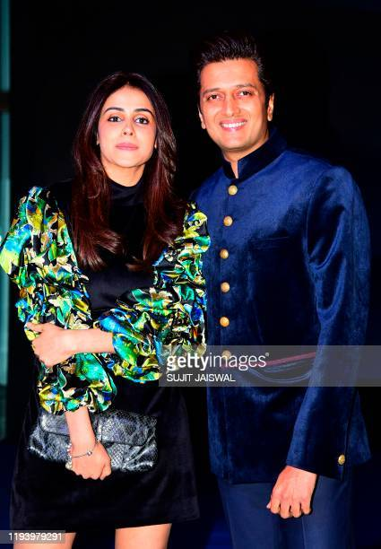 Bollywood actors Genelia D'Souza and Rteish Deshmukh arrive to attend an event with CEO of Amazon Jeff Bezos in Mumbai on January 16 2020