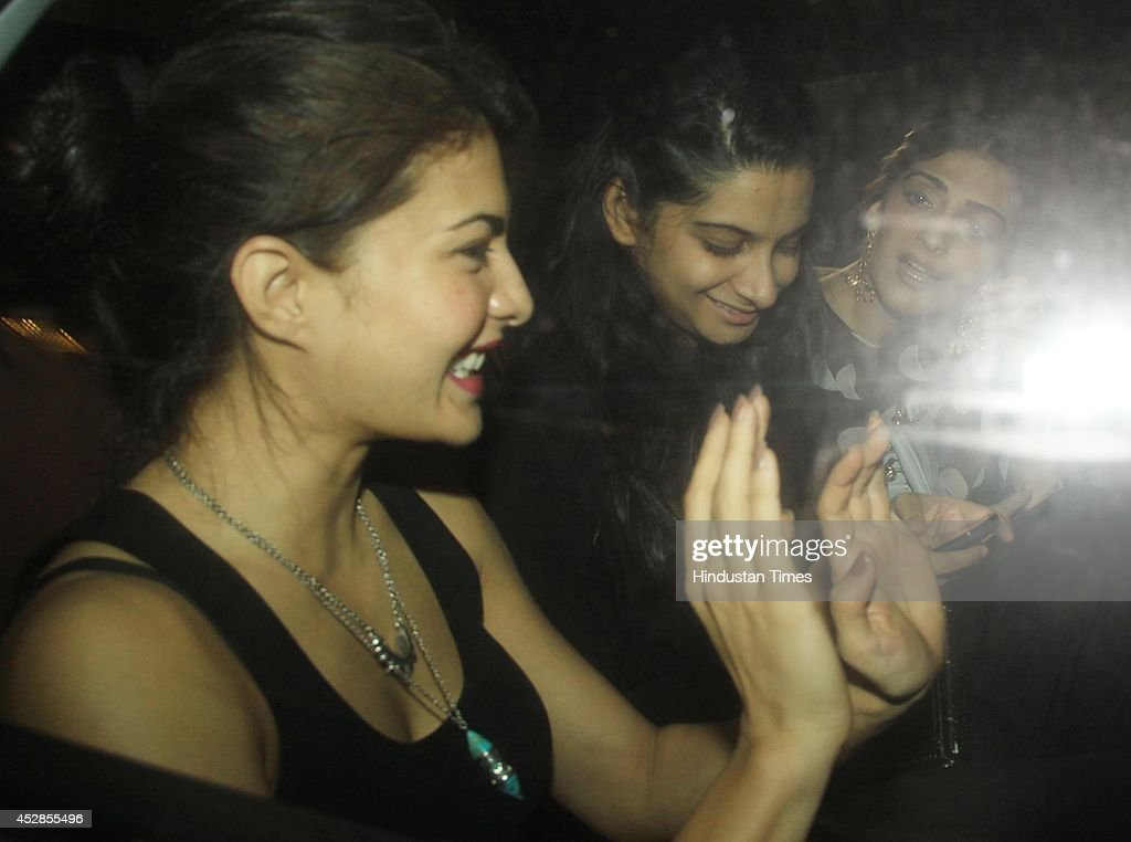 Bollywood actors Jacqueline Fernandez Rhea Kapoor and Sonam Kapoor leave after attending Karan Johars party organised at his residence on July 26...