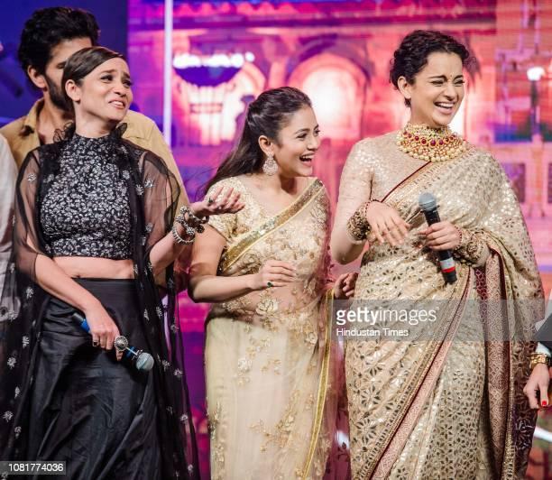 Bollywood actors Kangana Ranaut Ankita Lokhande and Mishti Chakraborty during a launch of the first song titled Vijayi Bhava from the film...