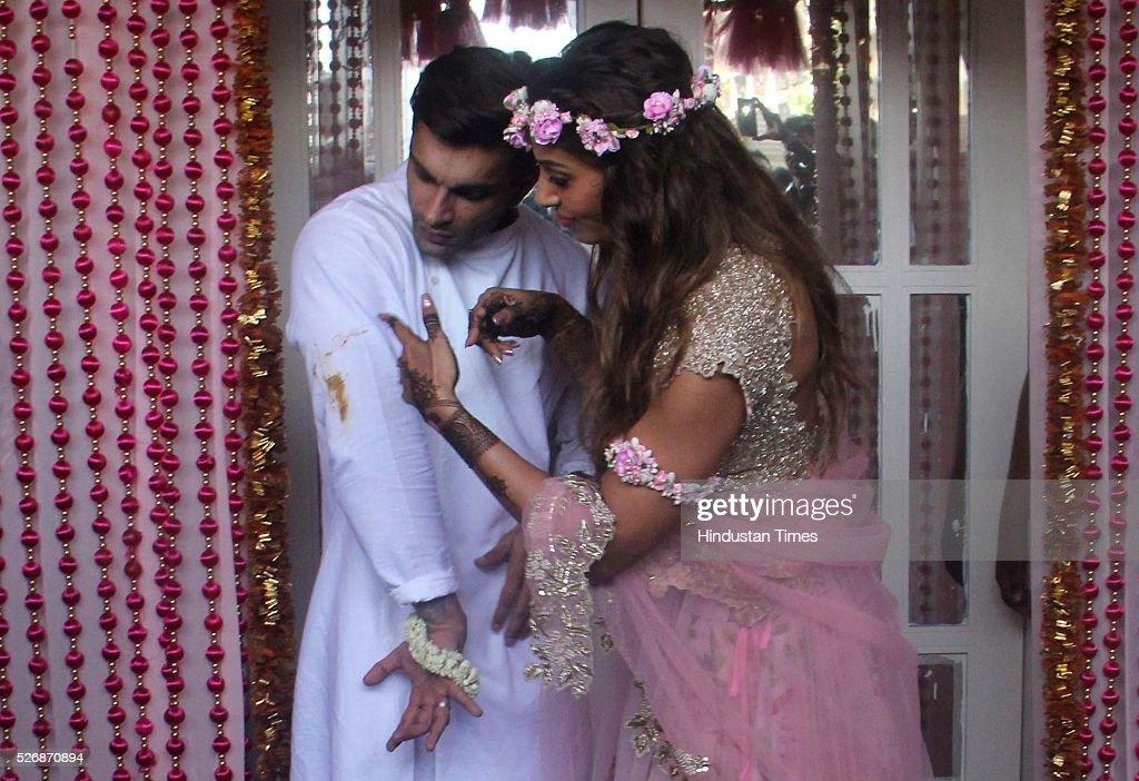 Bollywood actors Karan Singh Grover and Bipasha Basu during their Mehendi ceremony at Villa 69 Juhu on April 29 2016 in Mumbai India The day started..
