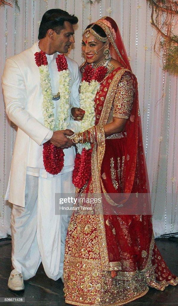 Bollywood actors Karan Singh Grover and Bipasha Basu pose during their wedding reception party at St Regis Hotel on April 30 2016 in Mumbai India