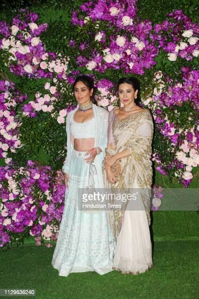 Bollywood actors Kareena Kapoor and Karisma Kapoor attending the wedding ceremony of Akash Ambani at JIO World Centre, BKC, on March 9, 2019 in...