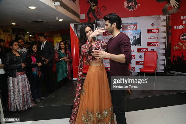 Bollywood actors Katrina Kaif and Aditya Roy Kapur perform a dance act during an interview for the promotion of their upcoming film Fitoor at HT...