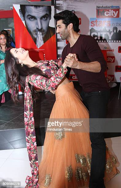 Bollywood actors Katrina Kaif and Aditya Roy Kapur perform a dance move during an interview for the promotion of their upcoming film Fitoor at HT...