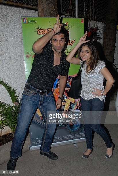 Bollywood actors Kushal Punjabi and Sumona Chakravarti during the screening of film Crazy Cukkad Family at Sunny Super Sound Studio Juhu on January...