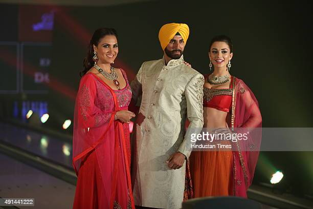 Bollywood actors Lara Dutta Akshay Kumar and Amy Jackson pose for a group photograph during the fashion show Style and the Sikh themed Bling at Essex...