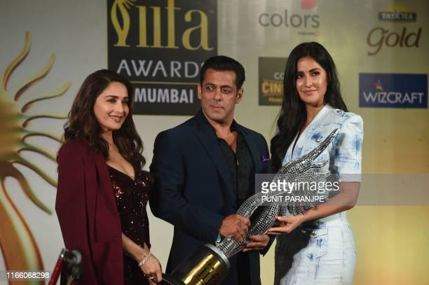 Bollywood actors Madhuri Dixit Salman Khan and Katrina Kaif pose during a press conference ahead of the 20th International Indian Film Academy Awards...
