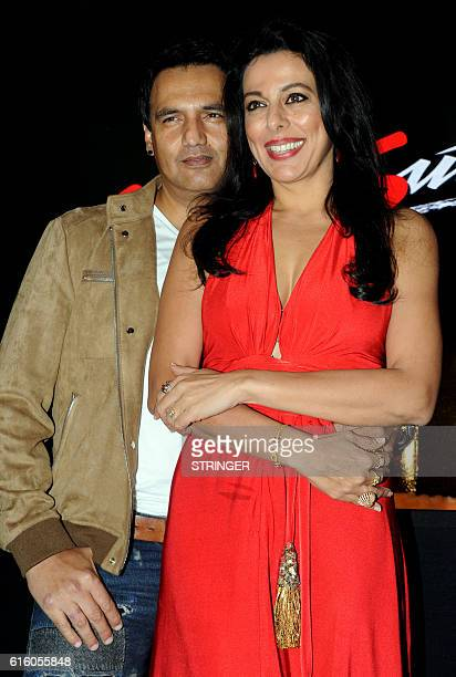 Bollywood actors Marc Robinson and Pooja Bedi pose during the KamaSutras Silver Jubilee Celebration and launch of Honeymoon Surprise Pack in India in...