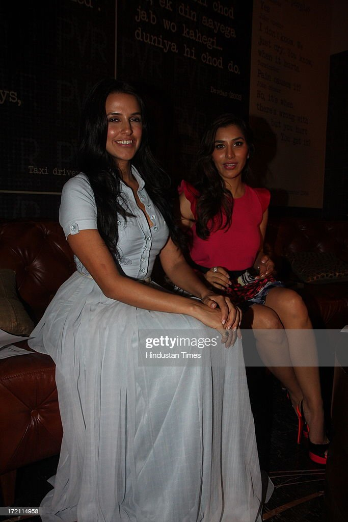 Bollywood actors Neha Dhupia and Sophie Chaudhary during the IIFA 2013 Press Conference at PVR Andheri on July 1 2013 in Mumbai India At a press...