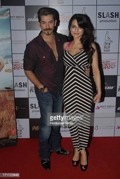 Bollywood actors Neil Nitin Mukesh and Ameesha Patel during a premiere of film Shortcut Romeo at PVR Juhu on June 20 2013 in Mumbai India
