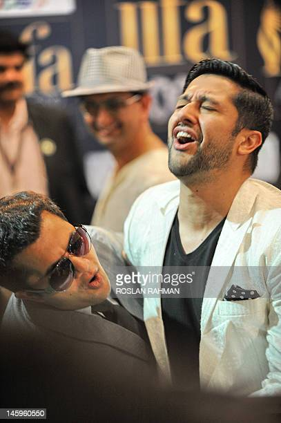 Bollywood actors Omi Vaidya and Aftab Shivadasani share a joke on the green carpet for the International Indian Film Academy Rocks concert in...