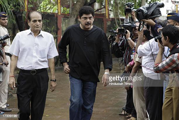 Bollywood actors Pankaj Dhir and Dharmesh Tiwari arrive to pay their last respects to Bollywood actor Pran during the cremation at Shivaji Park...
