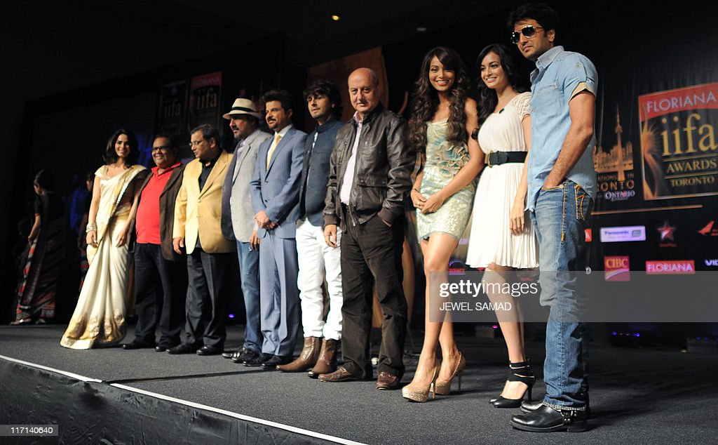 Bollywood actors pose on stage at the end of an introductory press conference on June 23, 2011 ahead of the 2011 International Indian Film Academy (IIFA) awards in Toronto, Ontario. AFP PHOTO/Jewel SAMAD