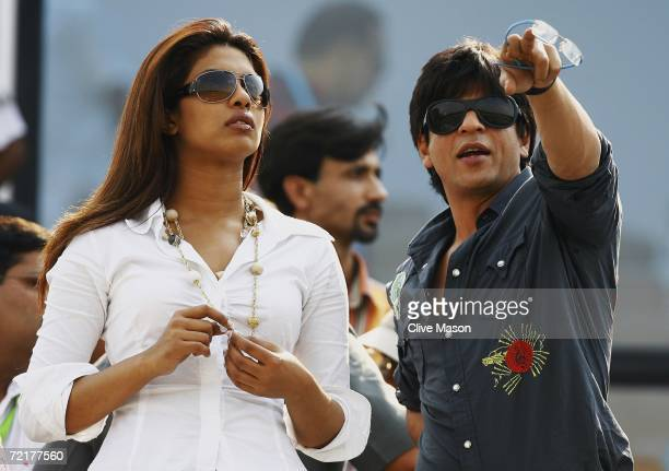 Bollywood actors Priyanka Chopra and Shah Rukh Khan watch the match between India and England at the Sawai Mansingh Stadium on October 15 in Jaipur...