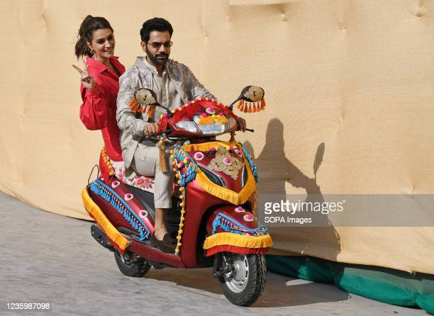 Bollywood actors Rajkummar Rao and Kriti Sanon arrive on a scooter for a promotional event of their upcoming film 'Hum Do Hamare Do' in Mumbai.