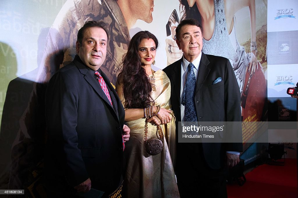 Bollywood actors Randhir Kapoor Rekha and Rajiv Kapoor during the premiere of Bollywood film `Lekar Hum Deewana Dil` on July 4 2014 in Mumbai India