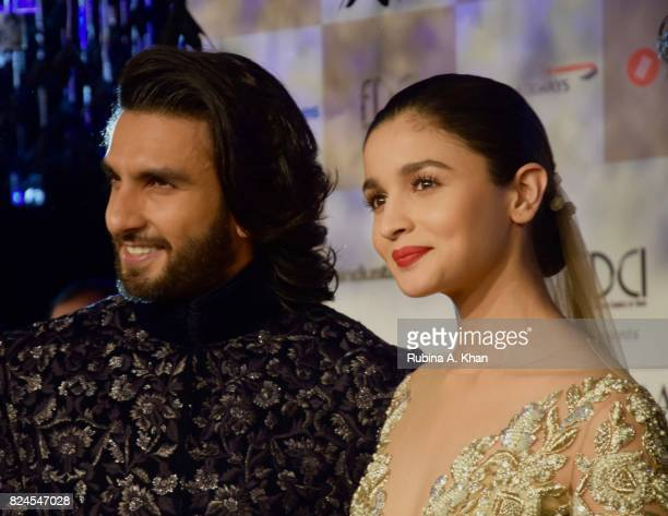 Bollywood actors Ranveer Singh and Alia Bhatt at the FDCI's India Couture Week 2017 at the Taj Palace hotel on July 30 2017 in New Delhi India