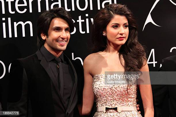 Bollywood actors Ranveer Singhand and Anushka Sharma pose on the red carpet during the 2011 Dubai International Film Festival on December 8 2011 in...