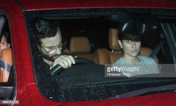 Bollywood actors Saif Ali Khan and Kareena Kapoor Khan arrive at Shashi Kapoor's residence at Prithvi Theater on December 4 2017 in Mumbai India...