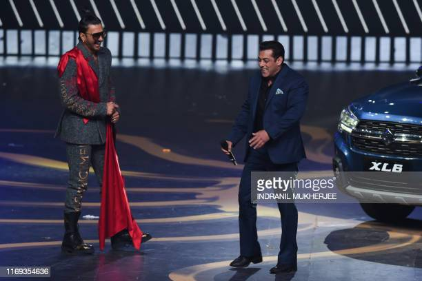 Bollywood actors Salman Khan and Ranveer Singh react on stage during the 20th International Indian Film Academy Awards at NSCI Dome in Mumbai on...