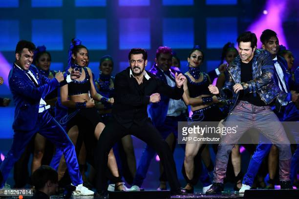 Bollywood actors Salman Khan and Varun Dhawan perform on stage during 18th International Indian Film Academy Festival at the MetLife Stadium in East...