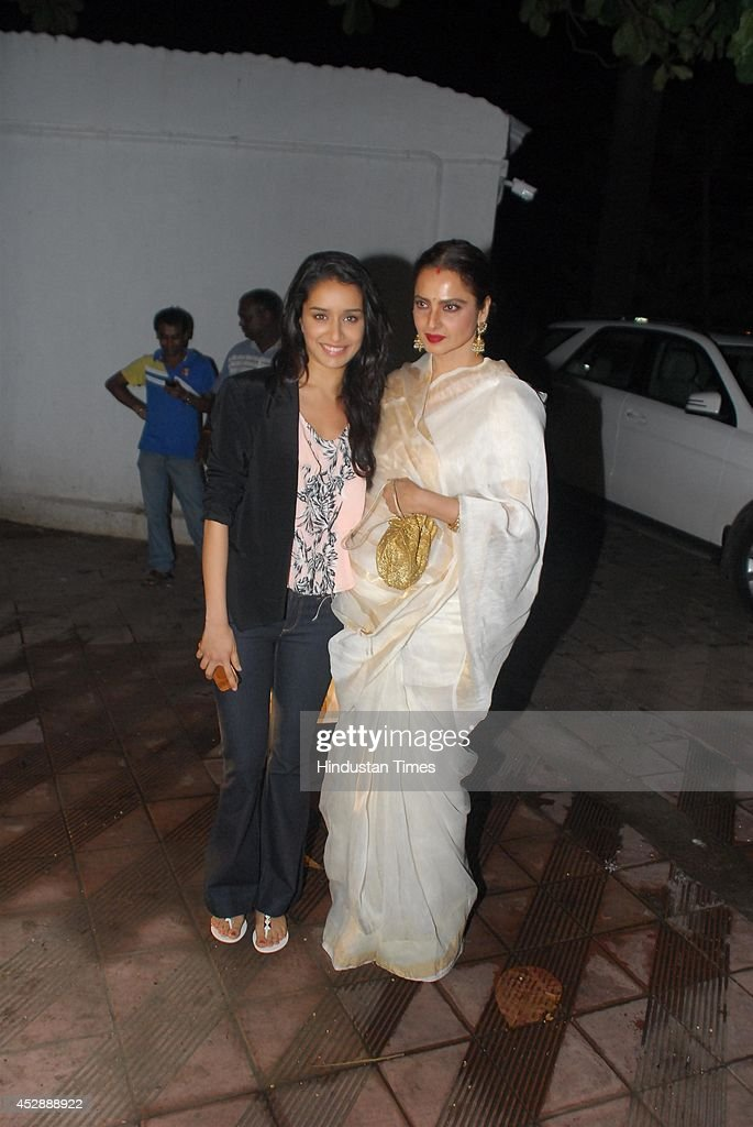 Bollywood actors Shraddha Kapoor and Rekha during the birthday celebration of Bollywood actor Priyanaka Chopra on July 25 2014 in Mumbai India