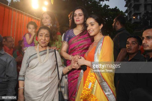 Bollywood actors Shraddha Kapoor Padmini Kolhapure and singer Asha Bhosale during the opening of Pandit Pandharinath Kolhapure Marg at JVPD Juhu on...