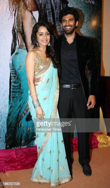 Bollywood actors Shraddha Kapoor with Aditya Roy Kapoor at Music launch of bollywood movie Aashiqui 2 on April 8 2013 in Mumbai India