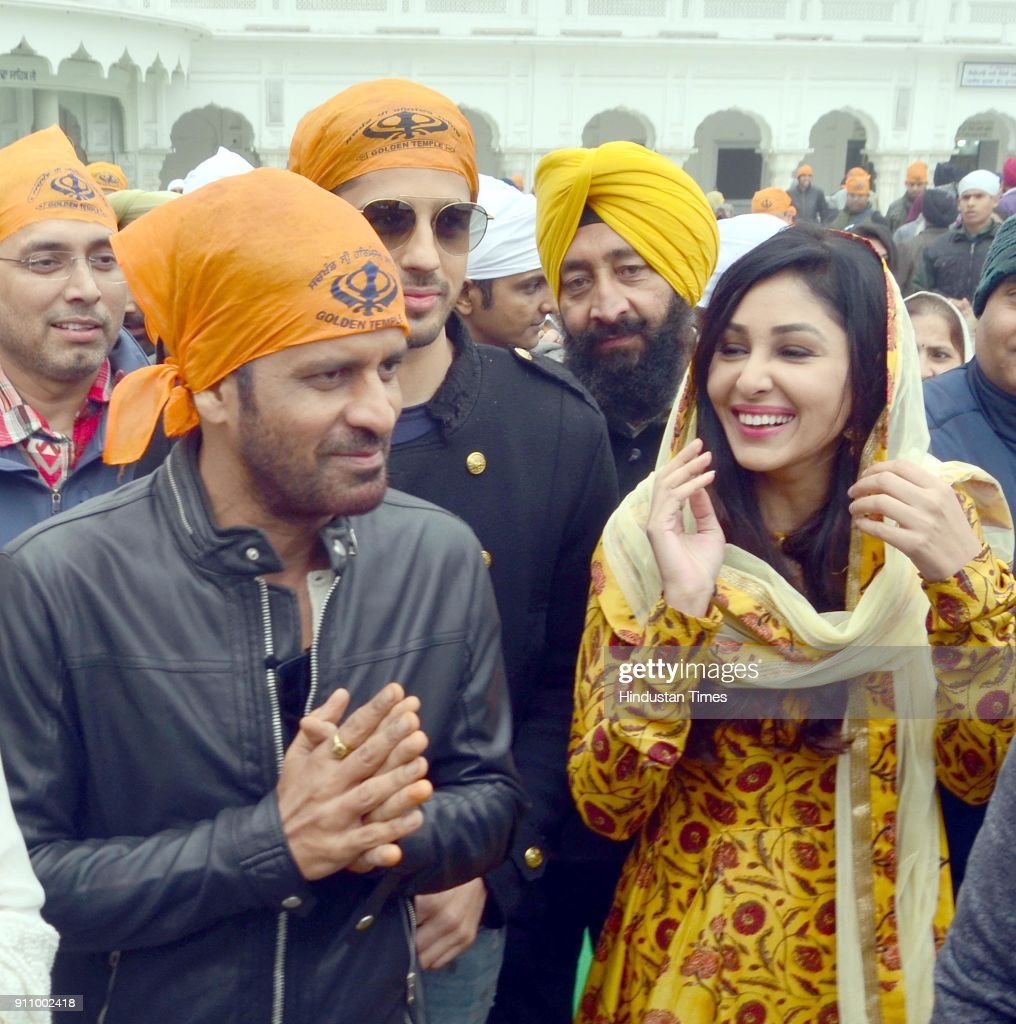 Bollywood actors Sidharth Malhotra Manoj Bajpayee and Pooja Chopra paying obeisance at Golden Temple at they visit the city for the promotions of...