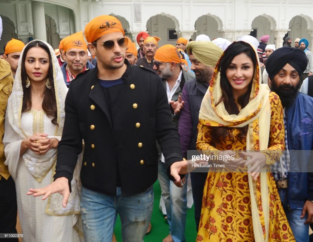 Bollywood actors Sidharth Malhotra Rakul Preet Singh and Pooja Chopra paying obeisance at Golden Temple at they visit the city for the promotions of..