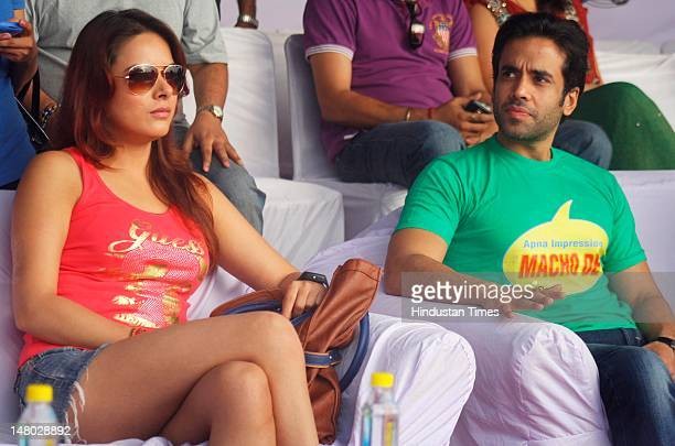 Bollywood actors Udita Goswami and Tusshar Kapoor attend the Marathon Noida 10k from Ramleela Ground, Noida Stadium at Sector 21A on July 8, 2012 in...