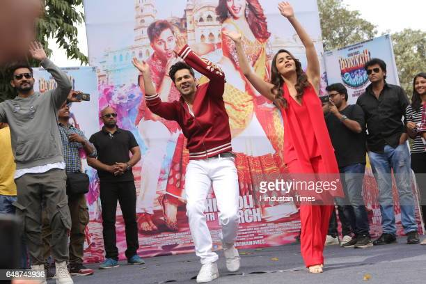 Bollywood actors Varun Dhawan and Alia Bhatt dance during promotion of their upcoming movie Badrinath Ki Dulhania at Hindu college of Delhi...