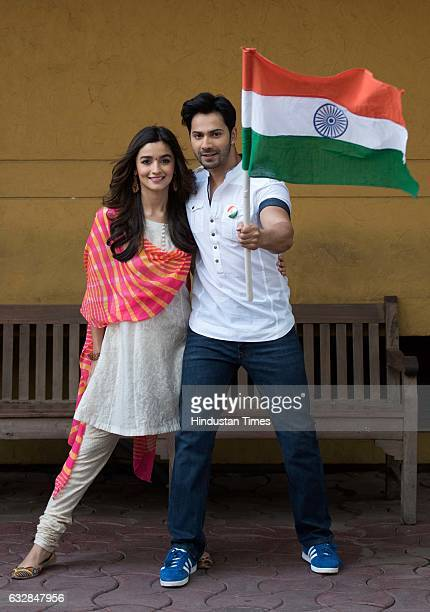 Bollywood actors Varun Dhawan and Alia Bhatt pose with Indian Flag during an exclusive interview with HT CafeHindustan Times for the Republic Day...
