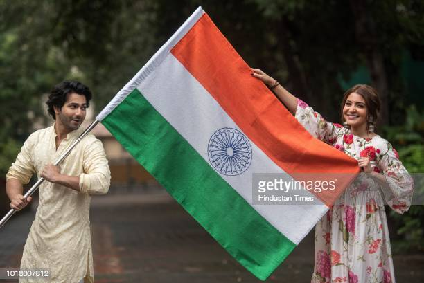 Bollywood actors Varun Dhawan and Anushka Sharma pose with the National Flag during an exclusive shoot with Hindustan Times for the Independence Day...