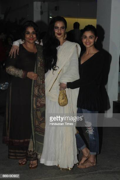 Bollywood actors Vidya Balan Rekha and Alia Bhatt during the special screening of film Begum Jaan at Sunny Super Sound Juhu on April 7 2017 in Mumbai...