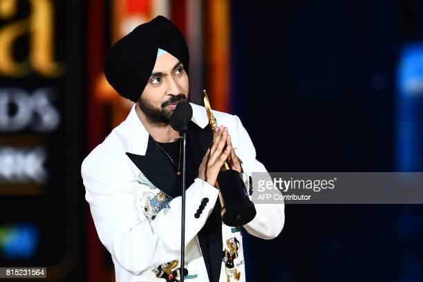 Bollywood actor/singer Diljit Dosanjh accepts Best Debut actor award during the 18th International Indian Film Academy Festival at the MetLife...