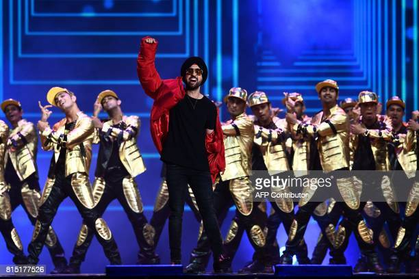 Bollywood actor/singer Diljit Dosanjh performs on stage durig IIFA award of the 18th International Indian Film Academy Festival at the MetLife...
