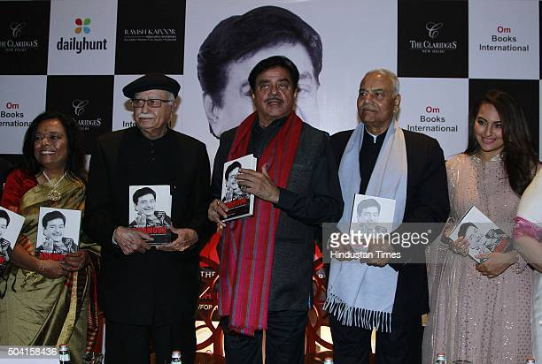 Bollywood actorturnedpolitician Shatrughan Sinha with his daughter and actor Sonakshi Sinha and politicians LK Advani and Yashwant Sinha during the...