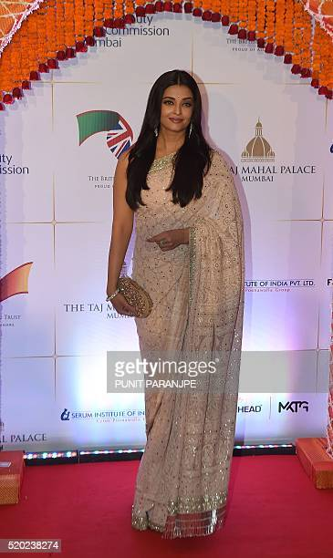 Bollywood actress Aishwarya Rai Bachchan poses for photographers after arriving for the Charity Gala reception attended by Britain's Prince William...